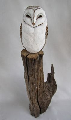 Barn owl on wood - stoneware with slip/stain/oxide glaze
