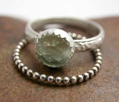 This is a beautiful set of two sterling stacking rings. One ring features a very sparkly color grade AA Prehnite faceted stone that measures 8mm. It is soldered to a patterned sterling silver band that is ~3mm in width. This fabulous ring is accompanied by a single beaded sterling band for a sweet stacking set. So light and comfortable, youll forget you are wearing them, until the glimmer of the stone catches your eye! I have formed, soldered, forged, finished and polished these beauties to…