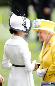def8eb1eede We Have Photo Proof That Queen Elizabeth Is Absolutely Charmed by Meghan  Markle