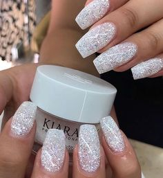 Here's everything you need to know about SNS or dip powder nails, from the best SNS nail colors to how you can get powder nails done at home, to the pros and cons of SNS nails. Cute Acrylic Nails, Cute Nails, Acrylic Nail Designs Glitter, Sparkle Acrylic Nails, Coffin Nails Glitter, Christmas Acrylic Nails, White Acrylic Nails With Glitter, White Chrome Nails, White And Silver Nails