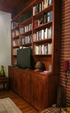 Built in living room shelving.  Wood against brick, this is about the depth thinking our built-ins will be.