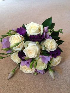 Bridesmaid Hand tied bouquet of white roses, purple lisianthus and lilac freesia – Hire Heaven Venue Decorating