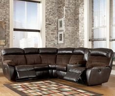 Berneen - Coffee Reclining Sectional with Right Side Console by Signature Design by Ashley