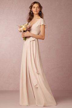 wrap dress with flutter sleeve, this neutral maids style has a slight blush tint to it | Zola Bridesmaid Dress in sand from BHLDN