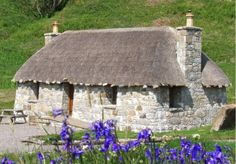 """Marketed as a """"lifestyle business,"""" the village includes four traditional Scottish blackhouses that have been restored in addition to the owner's modern five-bedroom house — complete with pitched, tiled roof that blends in with the surroundings."""