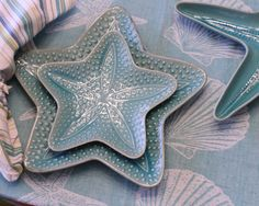 """In a gorgeous azure blue, guests will love table all made up. Available as both a Salad Plate(8.5"""" in diameter) or a Dinner Plate(12"""" in diameter). And, it looks marvelous in your open kitchen shelving too. Stoneware is microwave safe, oven-safe and dishwasher-safe. Don't miss the coordinate starfish plates and Sand & Shells table-topper. Starfish Azure items made in China. Shown with Starfish Azure Serving piece, sold separately. Choose size, correct price will appear in cart. To change…"""