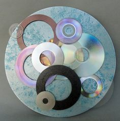 "www.greenlifegallery.com  ""Effervescent""  This piece was made from used and discarded CDs, DVDs and a Laser Disc.   The intent is to create original works of art while diverting waste from our landfills.  #CD #DVD #LaserDisc #plastic #art #eco-art #green #upcycled #recycled #media #disc #painting #reuse #creative décor"