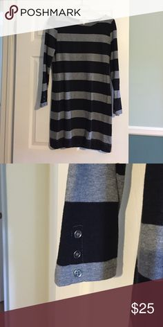 Banana Republic long sleeved dress Perfect to wear over leggings or tights with boots. Silver buttons at the end of the sleeves for design. Gray and black stripes. Like new banana republic dress. Banana Republic Dresses Long Sleeve
