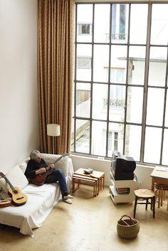 I just want that big beautiful window!!  Jeff Rian, home, playing guitar-  Apartamento magazine (Paris)