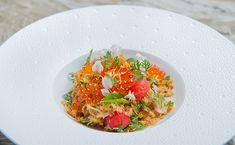 Watermelon & ground salmon with crispy shallots, roasted coconut & betel leaves