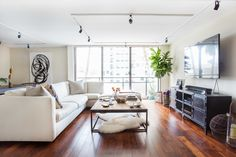 """The <a href=""""https://www.restorationhardware.com/"""" target=""""_blank"""">sectional, coffee table, and TV console</a> were already purchased by Michelle, but Haley helped arrange them in a more entertainment-friendly way."""