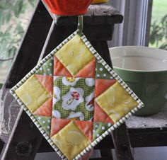 The Noble Wife: How to make a Quilted Potholder (i.e.: A Tutorial) Shows how to put a loop on a quilted potholder