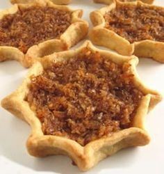 Jamaican Gizzada Recipe - a favourite amongst Jamaicans.It has a pie-crusted base with a filling of coconut and spices.