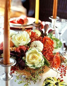 Thanksgiving Sumptuous Centerpiece:   Make the centerpiece as colorful as the rest of the table. Keep it compact so it doesn't interfere with the passing of dishes.