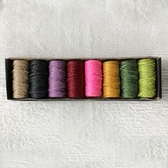 Great for the garden, gift wrapping and more, this set of eight twine rolls from Nutscene offers a variety of bright shades. Each roll of jute twine is produced on original 1920s machinery at a small, Scottish Mill.- Set of 8 - Jute twine, cellophane wrapper, plastic box- Indoor or outdoor use- UKEach roll: 50'