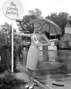 Actor Joi Lansing poses outside Chunky Candy Pavilion at the 1964 World's Fair. As Queen of Candy, Joi reigned over numerous special events at the candy exhibit while the rain poured. Candy Factory, Hollywood Heroines, Bizarre, World's Fair, Queen B, Beauty Pageant, Women Life, Famous Women, Up Girl