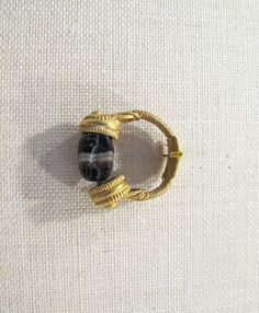 Gold swivel ring with banded agate scarab Period: Classical Date: 4th century B.C. Culture: Etruscan Medium: Agate, banded, gold