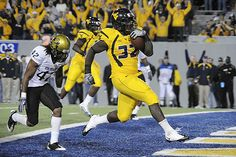 In 2009, WVU defeated the Colorado Buffaloes, then of the Big 12, 35-24 at Mountaineer Field. Not pictured, Noel Devine ran for 220 yards.