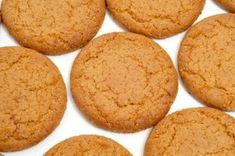 Four-ingredient coconut flour cookies. Completely eggless. The ingredients are coconut flour, butter, honey, and salt.