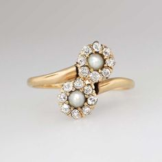 Special 1890's Victorian Old Mine Cut Diamond & Pearl Bypass Ring 14k | Antique & Estate Jewelry | SOLD: 7-31-15 Jewelry Finds Price: $1599.00 Two natural antique soft light grayish-cream 2mm seed pearls are safely set in between a halo of old mine cut diamonds in a bypass ring design made in rose-yellow 14k gold. A beautiful example of Victorian understated elegant jewelry
