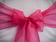 Chair Rentals- Hottest Pink Organza Chair Sash. Complete the look with a matching table runner or napkin. Check out our other fabrics at Eventrentalutah.com or follow our board on Pinterest
