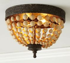 You know with is really just a boob light with beads instead of glass. Do it yourself. Elena Wood Bead Flushmount | Pottery Barn.