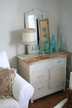 """Use Malachi's long white dresser as a """"table"""" behind sofa in new living room - can store things in it too and put lamps on top"""