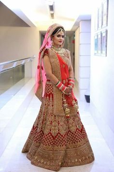 Get yourself dressed up with the latest lehenga designs online. Explore the collection that HappyShappy have. Select your favourite from the wide range of lehenga designs Indian Bridal Photos, Indian Bridal Outfits, Indian Bridal Fashion, Indian Bridal Wear, Indian Wedding Lehenga, Indian Wedding Bride, Bridal Red Lehenga, Desi Bride, Wedding Sarees