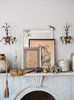 marble fireplace with mantel styled with vintage floral sconces, art, vessels and tassels. romantica sfgirlbybay / bohemian modern style from a san francisco girl Interior Styling, Interior Decorating, Interior Design, French Interior, Style At Home, Home Decoracion, Marble Fireplaces, Blog Deco, Fireplace Mantle