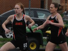 Ames' Ryan Weiss and Hannah Buckels exchange the baton during the sprint medley relay in the Jim Duea Invitational on Tuesday at Ames High Stadium. Photo by Nirmalendu Majumdar/Ames Tribune http://www.amestrib.com/sports/20170418/girls-track-ames-katelyn-moore-flies-in-1500