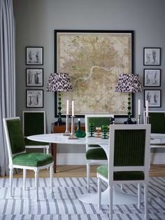 Grey dining room with green upholstered chairs by Ben Pentreath