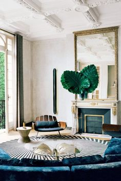 A sophisticated modern living room in an ornate Parisian apartment on @thouswellblog: