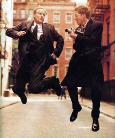 Owen Wilson and Wes Anderson running and jumping through the streets.