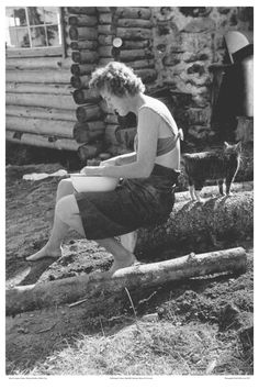"""JULIA CHILD IN LOPAUS, MAINE, SITTING OUTSIDE IN HALTER TOP, circa 1952, photograph by Paul Child."