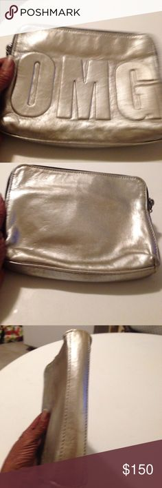 3.1 Philip Lim clutch Metallic zip around leather clutch.OMG  script on front. Very cute & good condition.  Clean interior   Signature name on inside leather trim. Only used a couple of times. Serial numbers inside   Very nice 3.1 Phillip Lim Bags Clutches & Wristlets