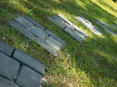 Granite-like cobblestones form a stepping path. >> http://www.diynetwork.com/blog-cabin/blog-cabin-2013-west-porch-pictures/pictures/index.html?soc=pinterest