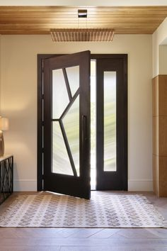 This Lecate Artisan Door is made from white oak wood and stands 10 feet high. It's designed with interlocking wood overlays bordering four sections of asymmetrical reed glass creating an impressive modern, contemporary entryway. Grill Door Design, House Gate Design, Tiny House Design, Modern Exterior House Designs, Modern Architecture House, Modern Design, Modern Contemporary, Door Design Interior, Luxury Interior Design