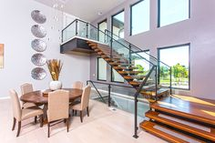 Wide modern staircase made out of Brazilian Cherry. © Jason Lugo