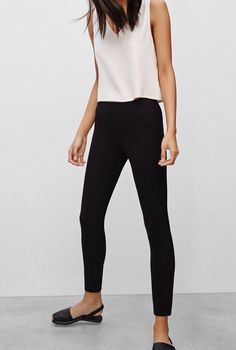Black stretch pants, white tank top, black sandals
