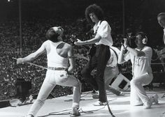 Freddie Mercury and Brian May on stage at Live Aid - Queen: their finest moment at Live Aid Queen Freddie Mercury, John Deacon, Bb King, Angus Young, Brian May, Louis Armstrong, Beastie Boys, Iggy Pop, Neil Young