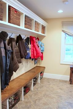 This looks like an easier option to build ourselves for the mudroom...it has the bench and hooks and overhead storage...and I bet it's cheaper than the complete built in units.