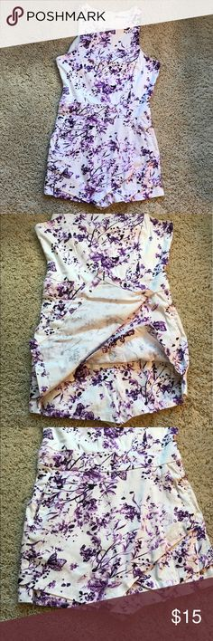 Asymmetrical racerback romper Super unique romper! Floral/butterfly pattern. Zipper in the back. Worn once, in perfect condition! Modlook 29 Pants Jumpsuits & Rompers