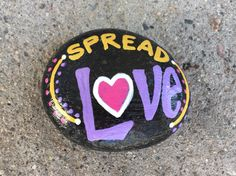 Spread Love. Hand painted rock by Caroline.