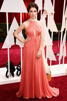 Anna Kendrick is wearing a Thakoon coral silk halter neck cut out gown at the 2015 Oscars