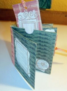 Lovely little book from scrapbook paper with pockets to store stuff.  Instructions from Plum Quilts.