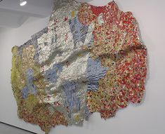 El Anatsui must be one of the greatest recyclers on the planet. Dirty, rusted and smashed liquor bottle caps are transformed into incredible tapestries that sparkle like precious metals in his current exhibition at Jack Shainman Gallery.