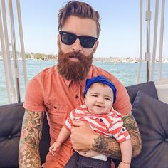 Levi Stocke with a baby - full thick red beard and mustache beards bearded man men mens' casual style street babies children bearding tattoos tattooed sailing summer redhead ginger #beardsforever