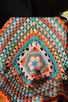 Baby blanket2 | Flickr - Photo Sharing!  Granny square blanket with African flower centre.  (No pattern.)