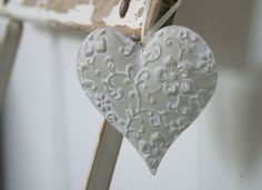http://www.theotherduckling.co.uk/embossed-hanging-heart-484-p.asp