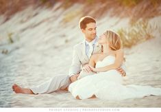 """wedding poses on beach.  I do this shot towards the end of my newlywed photo shoot or trash the dress. Many couples don""""t like to sit in the sand"""